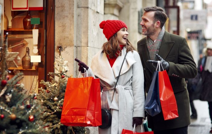 Holiday shopping, man and woman outside Christmas shopping