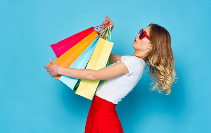 Woman holding shopping bags, spring and summer fashion